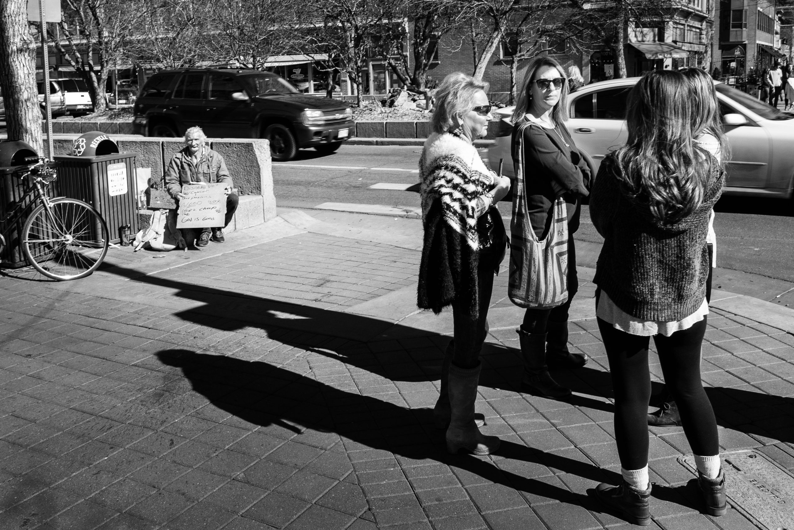 Disabled Veteran with jaw Cancer and heart problems is ignored by four women at the corner of Mountain Ave and College Ave in Fort Collins, CO. Spring 2018