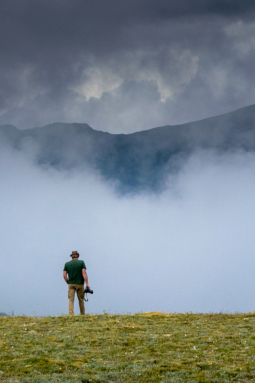 Hawk Buckman looking for another  photograph at the top of the Continental Divide in the Rocky Mountains of Colorado.